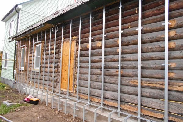 утепление деревянного дома цена